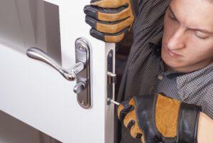 picture of locksmith replacing residential door lock at home