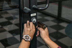 All City Locksmith is using tools to get a business owner back in their store after being locked out.